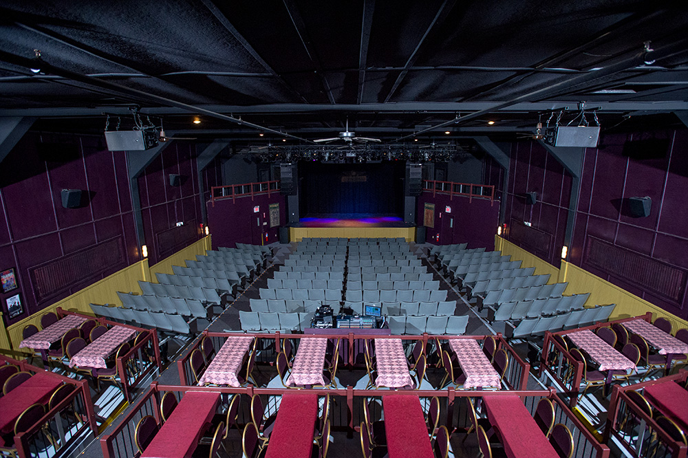 full view from back of house of floor seating and stage ahead